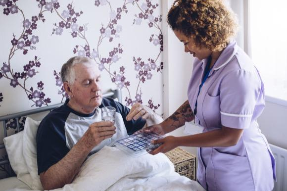 Home Care in Woking. Domiciliary carer providing personalised care to disabled man.